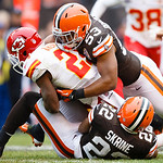 Kansas City Chiefs cornerback Javier Arenas (21) is tackled by Cleveland Browns linebacker Craig Robertson (53) and cornerback Buster Skrine (22) during an NFL football game in Cleveland, Su …