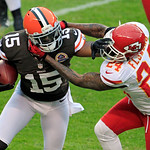 Cleveland Browns wide receiver Greg Little (15) tries to escape from Kansas City Chiefs cornerback Brandon Flowers after a catch in the second quarter of an NFL football game Sunday, Dec. 9, …