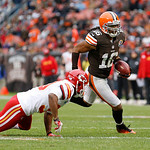 Cleveland Browns wide receiver Josh Cribbs (16) runs past Kansas City Chiefs cornerback Jalil Brown on an end around in the third quarter of an NFL football game Sunday, Dec. 9, 2012, in Cle …