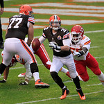 Cleveland Browns quarterback Brandon Weeden (3) tries to avoid a tackle during an NFL football game against the Kansas City Chiefs Sunday, Dec. 9, 2012, in Cleveland. (AP Photo/Tony Dejak)