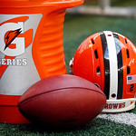 A Cleveland Browns helmet and football sit next to a Gatorade cooler during the first half of an NFL football game against the Dallas Cowboys Sunday, Nov. 18, 2012 in Arlington, Texas. (AP P …