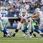 Dallas Cowboys quarterback Tony Romo (9) looks to hand the ball off to Dallas Cowboys running back Felix Jones (28) during the second half of an NFL football game against the Cleveland Brown …