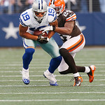Dallas Cowboys wide receiver Miles Austin (19) looks for room against Cleveland Browns cornerback Sheldon Brown (24) during the second half of an NFL football game Sunday, Nov. 18, 2012 in A …