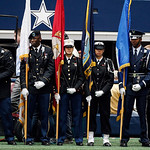 Members the armed services color guard wait to be introduced before the start of the first half of an NFL football game between the Dallas Cowboys and Cleveland Browns Sunday, Nov. 18, 2012  …