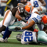 Cleveland Browns strong safety T.J. Ward (43) and Cleveland Browns offensive guard Ryan Miller (60) bring down Dallas Cowboys wide receiver Miles Austin (19) and Dallas Cowboys running back  …