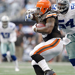 Dallas Cowboys inside linebacker Bruce Carter (54) tries to bring down Cleveland Browns running back Trent Richardson (33) during the first half of an NFL football game Sunday, Nov. 18, 2012 …