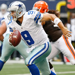 Dallas Cowboys quarterback Tony Romo (9) looks for room against the Cleveland Browns defense first half of an NFL football game Sunday, Nov. 18, 2012 in Arlington, Texas. (AP Photo/Sharon El …