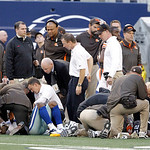 Trainers from both the Dallas Cowboys and Cleveland Browns check on Dallas Cowboys wide receiver Kevin Ogletree (85) and Cleveland Browns cornerback Buster Skrine (22) after they collided du …