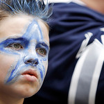 AJ John, 7, of Saginaw, Texas, watches the Dallas Cowboys and Cleveland Browns warmup before the start of the first half of an NFL football game Sunday, Nov. 18, 2012 in Arlington, Texas. (A …