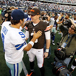 Dallas Cowboys quarterback Tony Romo (9) and Cleveland Browns quarterback Brandon Weeden (3) meet after overtime of an NFL football game Sunday, Nov. 18, 2012 in Arlington, Texas. (AP Photo/ …