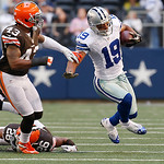 Dallas Cowboys wide receiver Miles Austin (19) looks for room against Cleveland Browns strong safety T.J. Ward (43) and Cleveland Browns cornerback Trevin Wade (26) second half of an NFL foo …