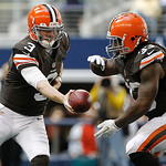 Cleveland Browns quarterback Brandon Weeden (3) hands the ball off to Cleveland Browns running back Trent Richardson (33) during the first half of an NFL football game against the Dallas Cow …