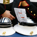 US Marines keep autographed souvenirs in their dress hats during the first half of an NFL football game between the Dallas Cowboys and Cleveland Browns Sunday, Nov. 18, 2012 in Arlington, Te …