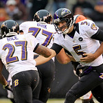Baltimore Ravens quarterback Joe Flacco (5) hands off to running back Ray Rice (27) in the third quarter of an NFL football game against the Cleveland Browns Sunday, Nov. 4, 2012, in Clevela …