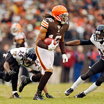 Cleveland Browns' Josh Cribbs returns a punt against Baltimore Ravens' Corey Graham (24) and Chykie Brown (23) in the third quarter of an NFL football game in Cleveland, Sunday, Nov. 4, 2012 …