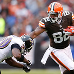 Cleveland Browns tight end Benjamin Watson (82) runs the ball as Baltimore Ravens free safety Ed Reed (20) tries to make a tackle in the second half of an NFL football game in Cleveland, Sun …