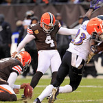 Cleveland Browns place kicker Phil Dawson (4) boots a 41-yard field goal from the hold of Reggie Hodges (2) in the fourth quarter of an NFL football game against the Baltimore Ravens, Sunday …