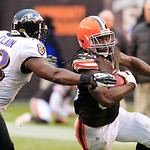 Cleveland Browns running back Trent Richardson, right, tries to escape the grasp of Baltimore Ravens linebacker Jameel McClain (53) in the third quarter of an NFL football game on Sunday, No …