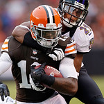 Cleveland Browns wide receiver Josh Gordon, left, is tackled by Baltimore Ravens cornerback Cary Williams (29) in the fourth quarter of an NFL football game in Cleveland, Sunday, Nov. 4, 201 …