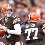 Cleveland Browns quarterback Brandon Weeden (3) drops back to pass as guard John Greco (77) blocks against the Baltimore Ravens in the first half of an NFL football game in Cleveland, Sunday …