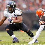 Baltimore Ravens running back Ray Rice (27) runs the ball as Cleveland Browns cornerback Sheldon Brown (24) tries to make a tackle in the first half of an NFL football game in Cleveland, Sun …