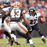 Baltimore Ravens running back Ray Rice (27) runs the ball as Cleveland Browns strong safety T.J. Ward (43) and defensive end Frostee Rucker (92) defend in the first half of an NFL football g …