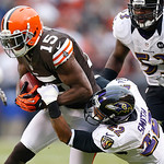 Cleveland Browns wide receiver Greg Little (15) is tackled by Baltimore Ravens cornerback Jimmy Smith (22) after he makes a reception in the second half of an NFL football game in Cleveland, …