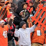 Cleveland Browns fans cheer the defense in the third quarter of an NFL football game against the Baltimore Ravens Sunday, Nov. 4, 2012, in Cleveland. (AP Photo/Tony Dejak)