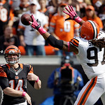 Cleveland Browns defensive end Jabaal Sheard (97) tips a pass from Cincinnati Bengals quarterback Andy Dalton (14) in the first quarter of an NFL football game Sunday, Oct. 14, 2012, in Clev …
