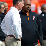 Cleveland Browns head coach Pat Shurmur, left, and Cincinnati Bengals head coach Marvin Lewis talk before an NFL football game Sunday, Oct. 14, 2012, in Cleveland. (AP Photo/Tony Dejak)