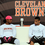 Cleveland Browns wide receiver Josh Cribbs, left, and Joe Haden sit on the bench and talk before the Browns play the Cincinnati Bengals in an NFL football game Sunday, Oct. 14, 2012, in Clev …
