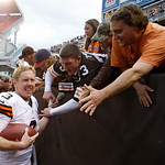 Cleveland Browns quarterback Brandon Weeden celebrates with fans after the Browns defeated the Cincinnati Bengals 34-24 in an NFL football game Sunday, Oct. 14, 2012, in Cleveland. Weeden go …
