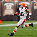 Cleveland Browns' Josh Cribbs returns a punt against the Cincinnati Bengals in the third quarter of an NFL football game Sunday, Oct. 14, 2012, in Cleveland. (AP Photo/Tony Dejak)