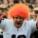 A Cleveland Browns fan celebrates during  an NFL football game between the Cleveland Browns and the Cincinnati Bengals Sunday, Oct. 14, 2012, in Cleveland. (AP Photo/Tony Dejak)