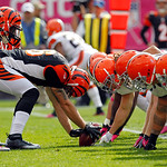 Cincinnati Bengals long snapper Clark Harris, center, prepares to snap on a punt against the Cleveland Browns, right, in the first quarter of an NFL football game Sunday, Oct. 14, 2012, in C …
