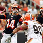 Cincinnati Bengals quarterback Andy Dalton (14) passes over Cleveland Browns defensive tackle Billy Winn (90) in the second quarter of an NFL football game Sunday, Oct. 14, 2012, in Clevelan …
