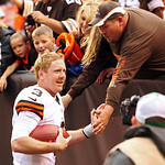 Cleveland Browns quarterback Brandon Weeden celebrates with fans after a 34-24 win over the Cincinnati Bengals in an NFL football game Sunday, Oct. 14, 2012, in Cleveland. Weeden got his fir …