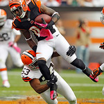 Cincinnati Bengals wide receiver Armon Binns (85) gets tackled by Cleveland Browns linebacker Craig Robertson (53) during an NFL football game Sunday, Oct. 14, 2012, in Cleveland. (AP Photo/ …