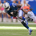 Indianapolis Colts' Donnie Avery is tackled by Cleveland Browns' Usama Young following a reception during the first half of an NFL football game Sunday, Oct. 21, 2012, in Indianapolis. (AP P …