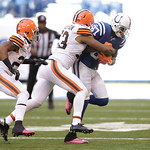 Indianapolis Colts' Reggie Wayne (87) is tackled by Cleveland Browns' Craig Robertson (53) and Buster Skrine (22) during the second half of an NFL football game Sunday, Oct. 21, 2012, in Ind …