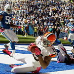 Cleveland Browns' Greg Little makes a 14-yard touchdown reception against Indianapolis Colts' Jerrell Freeman (50) and Cassius Vaughn (32) during the first half of an NFL football game Sunda …