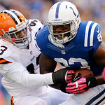 Indianapolis Colts' Dwayne Allen (83) is tackled by Cleveland Browns' T.J. Ward following a reception during the second half of an NFL football game, Sunday, Oct. 21, 2012, in Indianapolis.  …