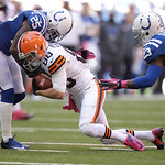 Cleveland Browns' Josh Cooper is tackled by Indianapolis Colts' Jerraud Powers (25) during the first half of an NFL football game Sunday, Oct. 21, 2012, in Indianapolis. (AP Photo/Michael Co …