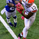 Cleveland Browns' Josh Gordon (13) makes a 33-yard touchdown reception against Indianapolis Colts' Jerraud Powers during the second half of an NFL football game, Sunday, Oct. 21, 2012, in In …