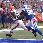 Cleveland Browns' Benjamin Watson runs against Indianapolis Colts' Moise Fokou during the first half of an NFL football game Sunday, Oct. 21, 2012, in Indianapolis. (AP Photo/Michael Conroy)