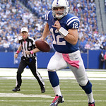 Indianapolis Colts' Andrew Luck runs for a 5 yards for a touchdown during the first half of an NFL football game against the Cleveland Browns Sunday, Oct. 21, 2012, in Indianapolis. (AP Phot …
