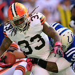 Cleveland Browns' Trent Richardson (33) is tackled by Indianapolis Colts' Kavell Conner (53) during the first half of an NFL football game on Sunday, Oct. 21, 2012, in Indianapolis. (AP Phot …
