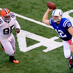 Indianapolis Colts' Andrew Luck (12) passes as Cleveland Browns' Juqua Parker chases during the second half of an NFL football game, Sunday, Oct. 21, 2012, in Indianapolis. (AP Photo/AJ Mast …