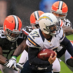 San Diego Chargers safety Eric Weddle (32) is chased down by Cleveland Browns linebacker James-Michael Johnson (50) and others on a punt return in the third quarter of an NFL football game S …