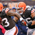 Cleveland Browns running back Trent Richardson (33) gets a shove from guard Shawn Lauvao on his way to a 26-yard touchdown against the San Diego Chargers in the first quarter of an NFL footb …